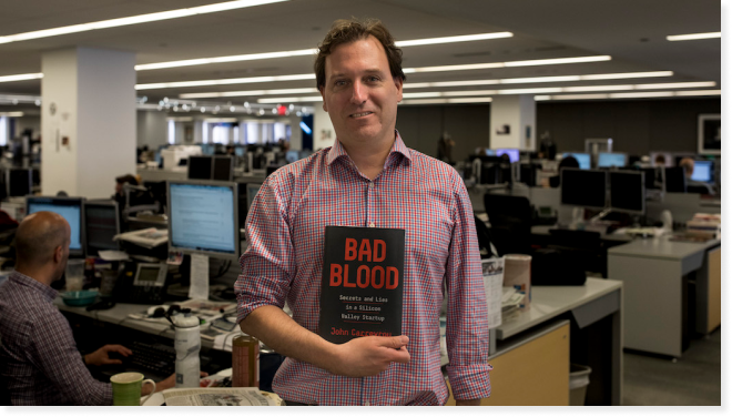 Picture of John Carreyrou with his book Bad Blood. Courtesy of Benjamin Meteyer